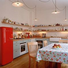 Red fridge, timber bench tops.
