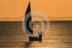 Photo about Silhouette of fishing boat at sunrise - Inhassoro - Mozambique. Image of landscape, beauty, equator - 53541827