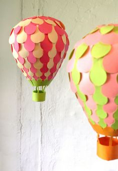 Paper balloon with cutting template; see how to weave balloons in this video tutorial. http://www.youtube.com/user/PaperMatrix