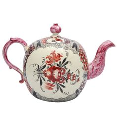 A Rare English Creamware Chintz Teapot - A rare English creamware teapot painted with chintz borders and King's Rose on the front and back. Circa 1770. LENGTH: 7 in. (18 cm) DEPTH: 4 in. (10 cm) HEIGHT: 4.5 in. (11 cm) Leo Kaplan Ltd., New York
