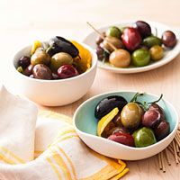 The gorgeous Spiced Olives by Rachael Ray couldn't be simpler. Simmer EVOO, lemon and orange zest, rosemary, and red pepper, then add mixed unpitted olives and marinate 20 minutes.
