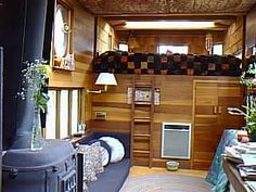 Jeannie's Reo Bus Conversion. The sleeping loft is a cab-over above the drivers seat, while the door to the right allows access to the front, which is used as a hanging closet while the bus is docked.  MrSharkey.Com