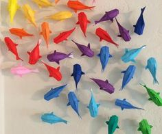 Wall of Rainbow Origami Koi - DIY Wall hanging. This is so wicked, I'm thinking of pulling my sadly neglected origami paper out of storage! <3
