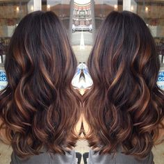 chocolate brown with caramel highlights.----- red highlights instead of caramel