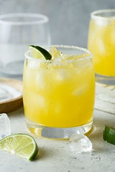 You don't have to wait for your next warm-weather escape to enjoy a tropical cocktail. This quick & easy Mango Margarita recipe makes you feel like you could sipping it poolside at your favorite resort - all from the comfort of your home. Grapefruit Margarita Recipe, Blueberry Margarita, Blood Orange Margarita, Margarita Salt, Margarita On The Rocks, Mango Margarita Recipes, Sweet Margarita Recipe, Mango Recipes, Lemon Recipes