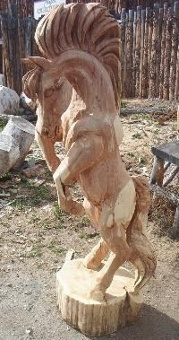 Chainsaw carved cedar horse by artist Faye Braaten of Loveland Colorado