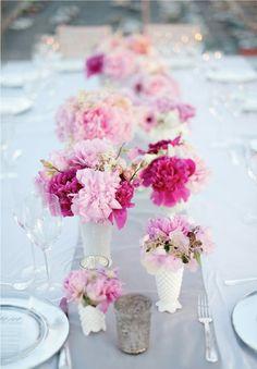 fuchsia and light pink flowers + white milk glass vases = beautiful wedding centerpieces!