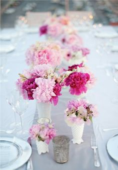 fuchsia and light pink flowers + white milk glass vases = beautiful wedding centerpieces!