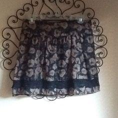Black and brown skirt Very cute black and brown skirt. Has elastic waist band.   Very cute with leggings Stoosh Skirts Midi