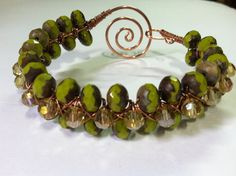 Czech glass copper wire wrapped bracelet.  Agapewirejewelry.etsy.com