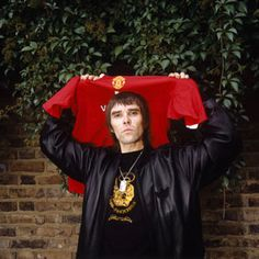 Ian Brown, lead singer of seminal Manchester band The Stone Roses, poses here with a shirt. The frontman is a regular at Old Trafford. Good Soccer Players, Soccer Fans, Football Fans, Stone Roses Manchester, Manchester United Shirt, Old Trafford, Man United, Famous Faces, Music Is Life