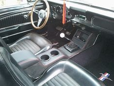 The interior is black. Ford Mustang 1967, Ford Mustang Interior, Mustang Fastback, Ford Mustang Gt, 1966 Chevy Truck, New Car Accessories, Custom Consoles, Vintage Mustang, Custom Car Interior