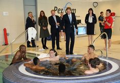 William and Kate chat to England squad relaxing in the jacuzzi at St George's Park.