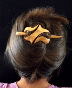 The original hair piece consists of two parts; the hand-carved ornament which covers the hair and the hair stick made to match the shape of the