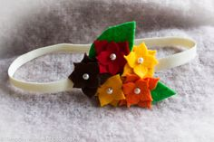 Autumn / fall felt floral headband with pearl and leaf accents and a cream elastic band on Etsy, $4.00 CAD
