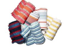 These striped blankets are just the thing for a sunny day at the beach or in the park.