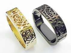 """BSI Set 1 Gold And 1 Titanium Black Metal Bracelets For Fitbit Flex Activity Tracker Flowers Design Replacement Wrist Bands 6 - 7"""" Large Size. For Fitbit FLEX only. Tracker not included. Elegant Fashion Jewelry Accessory Bangles For Your Fitness Monitor + Blue Velvet Soft Pouch With BSI(TM) Logo As FREE Gift. Smooth Edge Stainless Steel Material Gives You Luxurious And Stylish Look. Weighs around 2.7 oz (76.5 grams) each, Width is around 0.7in. (1.5cm), Circumference is 7in. (17.78cm)…"""