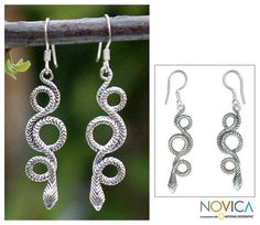 These beautiful earrings feature a snake design twisted into multiple loops. The earrings are crafted of fine sterling silver and dangle from hook findings.