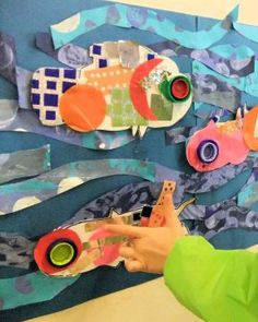 Hannah's Art Club collage fish with bottle cap eyes