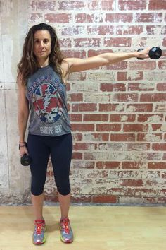 Get sexy shoulders in 10 minutes with this do-at-home strength workout from Jennifer Cohen! It starts with this Single Arm Lateral Raise.