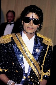 Michael Jackson At The 26th Grammy Awards. He won 7 Grammy Awards that night. Peep the glistening jacket and aviators!