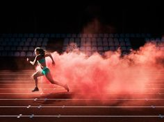 View top-quality stock photos of Athlete Running In Red Smoke. Find premium, high-resolution stock photography at Getty Images. Track Senior Pictures, Running Pictures, Senior Pics, Grad Pics, Senior Year, Sport Photography, Fitness Photography, Photography Training, Photography Guide
