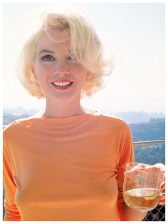 Marilyn Monroe with her favorite drink in hand - Dom Perignon!