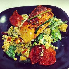 Baked salmon over Caesar salad and a veggie couscous. Follow my Instagram for more low calorie meal ideas! @robolikes
