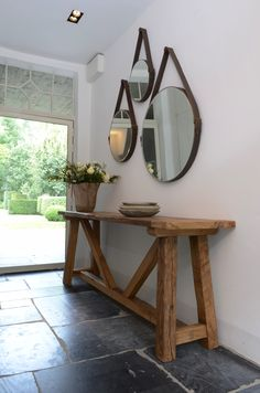 Celles aged brown leather mirrors and The Vill console table all available from behomecollection.com