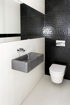 Monochrome cloakroom with large mirror to emphasise light and space with a gorgeous Synergie wall mounted waterfall mixer tap by VADO - perfection!