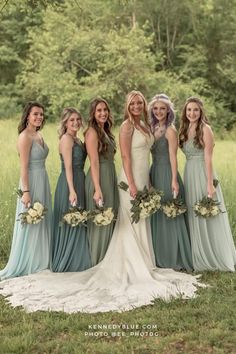 Loving this mismatched bridal party! They are wearing Sage, Moss, Deep Sea, and Sea Glass colored bridesmaid dresses in the style 'Cameron' from Kennedy Blue! Find your perfect shade & size today or order a FREE color swatch from Kennedy Blue! // green bridesmaid dresses // mix and match bridesmaid dresses // rustic wedding // outdoor wedding // unique bridal party ideas // shades of green bridesmaid dresses // long chiffon bridesmaid dress // Kennedy Blue Affordable Bridesmaid Dresses, Mismatched Bridesmaid Dresses, Lace Bridesmaid Dresses, Wedding Dresses, Wedding Unique, Rustic Wedding, French Lilac, Chiffon Gown, Party Looks