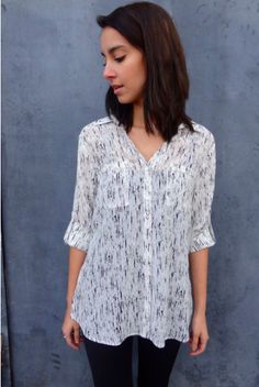 Sheer black & white blouse with a wide collar, two breast pockets, rolled sleeves // Chic Blouse by Dex $52