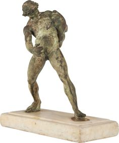 A GRECO-ROMAN STYLE BRONZE FIGURE OF AN ATHLETE ON MARBLE BASE AFTER VARLESE, circa 1900.