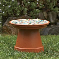 mosaic flowerpot bird bath. I also saw one that was stacked pots of different sizes and painted. I like the mosaic of this one