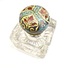 Champleve top inkwell with cut glass base, early 20th century. Offered by Louise Verber. Alfies Antique Market.