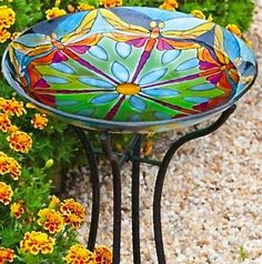 Painted glass bird baths are vibrant artworks with vivid color to enhance any setting and entice more songbirds in high style! Using designs found in nature, these large glass bowls feature hand paint
