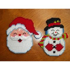 2 Christmas Refrigerator Magnets Santa Claus Face Snowman Needle Point... ($10) ❤ liked on Polyvore featuring home, home decor, holiday decorations, snowman home decor and canvas home decor
