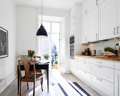 Love the mixed woods offsetting the white kitchen.
