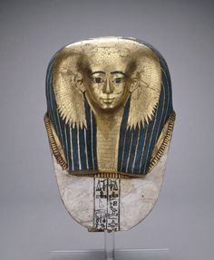 "Mummy mask, Early 18th Dynasty Ancient Egypt, 1500 BCE ""Cartonnage mummy-mask of Satdjehuty: on this splendid female mask, gold leaf not only covers the woman's face, but also her huge collar necklace..."