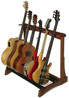 multi-stringed instrument stand - if the pegs were a little closer together in a couple spots, we could also store our smaller stuff too - uke, mando, etc.