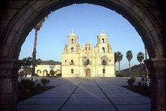 View of La Purísima Concepción de Caborca through an arch at the entrance.