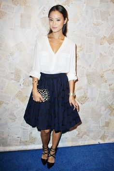 Jamie Chung in a white blouse, full skated skirt, and Valentino pumps.
