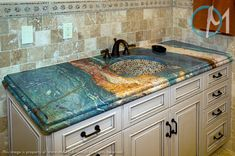 This vanity features the extremely exotic Van Gogh granite. The blue, orange, and tan veins flow through this stone like paint on canvas. The laminated edge adds to this vanity's beauty.
