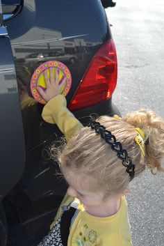 Keeping safe in the parking lot - always have your kiddo touch the same spot on your car while they're waiting for you to help them in and out of the car.