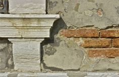 Crumbling; architectural detail; Santa Maria della Salute area; Venice, Italy.  December 2014.