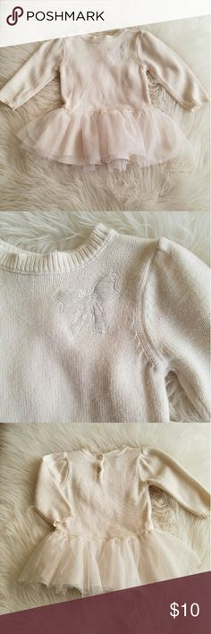 Great Baby top Baby girl top. In excellent condition. Tunic style. So it fits a little last the waist. Tutu skirt bottom. Great to pair with leggings. Off white cream color with silver bow. Great from 6-9 months.   53% cotton 40% viscose  7% nylon Shirts & Tops Blouses