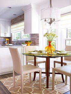 Seamless Transition..A small dining area blends into the kitchen with its neutral color palette and clean lines.