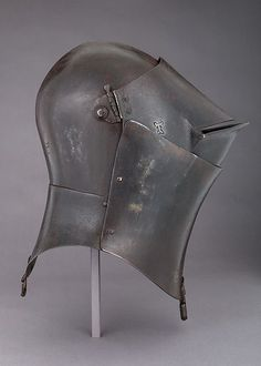Although very similar helmets are depicted in early fifteenth century works of art, almost no other actual examples of this type exist today. Perhaps originally designed for use in battle, it appears to have been converted into a jousting helmet during its working lifetime