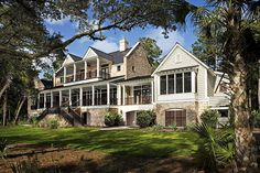 Pearce Scott Design under prior association: In this beautiful, brick, river-front home, a wide porch and many windows are key!