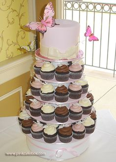 Wedding Cupcake Tree with cake on top for bride and groom to cut. Cute idea :)